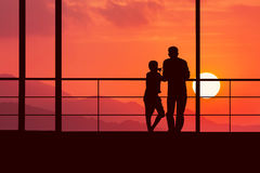 Son and dad see sunset. At mountain Royalty Free Stock Image