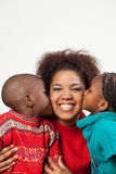 Son and daughter kissing her mother. Black son and daughter kissing her mother royalty free stock photography