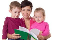 Son and daughter listening their mother reading book. Isolated on white Stock Image