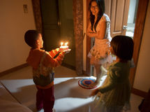 Son daughter preparing surprise. For mother's birthday royalty free stock photos