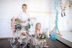 Son and daughter in a white room stock photography