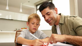 Son drawing with his dad at the table Royalty Free Stock Photos