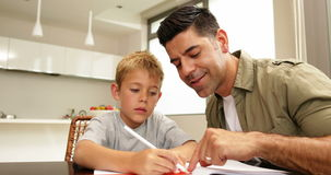 Son drawing with his dad at the table Stock Image