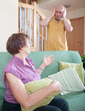Son and elderly mother during  quarrel. Quarrel between an elderly mother and adult son Stock Photo