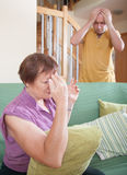 Son and elderly mother during  quarrel. Adult son and elderly mother during  quarrel  at home Stock Photography