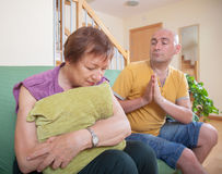 Son and elderly mother during  quarrel. Adult son and elderly mother during  quarrel  at home Royalty Free Stock Photos