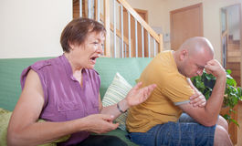 Son and elderly mother during  quarrel. Adult son and elderly mother during  quarrel  at home Royalty Free Stock Photography