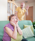 Son  and elderly mother during  quarrel. Adult son and elderly mother during  quarrel  at home Royalty Free Stock Image