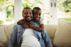 Son embracing his father at home. Portrait of son embracing his father at home Stock Image