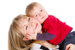 Son embracing mother. Loving baby son embracing his mother stock photo