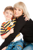 Son embracing mother. Preschool son embracing his mother stock photography