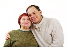 Son enfolding his mother. Man enfolding his mother, horizontal photo stock photo