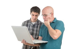A son explains to his father the laptop Royalty Free Stock Image