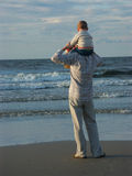 Son and father. Standing at the shore and looking at the Baltic sea Stock Image