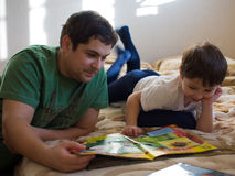 Son with Father. Reading a book Royalty Free Stock Photo