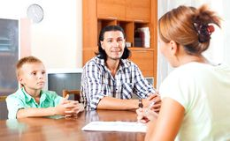 Son and father answer questions. Of a social worker in home royalty free stock image