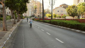 Son and father bike on deserted street stock video footage