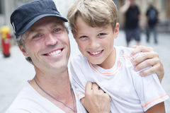 Son with father in city Royalty Free Stock Images