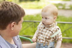 Son and father communication. Сurious baby boy son looks questioningly at father during the play royalty free stock photography