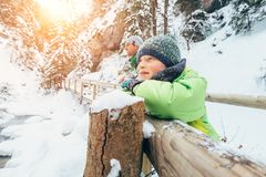Son with father enjoy beautiful winter nature in mountain canyon Royalty Free Stock Images