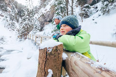 Son with father enjoy beautiful winter nature in mountain canyon Stock Photography