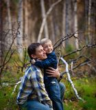 Boy and father in fall time royalty free stock photography