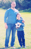 Son and father at football field Stock Photography