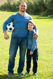 Son and father at football field Stock Photo