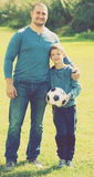 Son and father at football field Royalty Free Stock Photos