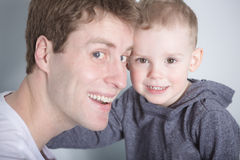 Son with father forehead to. A Son with father forehead to at home bed Royalty Free Stock Images
