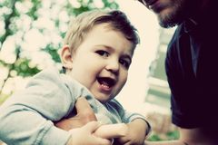 Son with father, happy moments together. Childhood, vintage Stock Photography