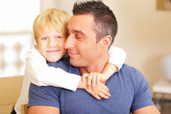 Son and father having fun. At home Royalty Free Stock Photos