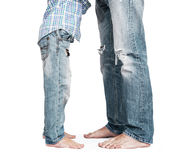 Son and father legs in tattered jeans royalty free stock images
