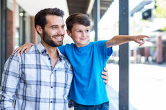 Son and father look away. At the mall royalty free stock photo