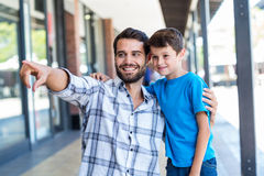 Son and father look away Royalty Free Stock Photo