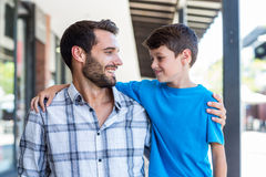 Son and father look at each other Royalty Free Stock Photo