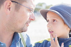 Son father look each other talk. Closeup outdoor Royalty Free Stock Photo