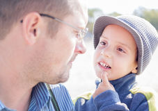 Son and father looking each other eyes. Closeup outdoor Stock Photography