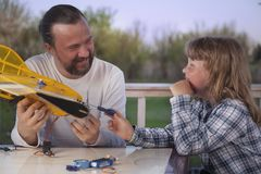 Son and father made homemade radio-controlled model aircraft ai Royalty Free Stock Image