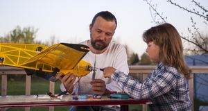 Son and father made homemade radio-controlled model aircraft ai stock photos