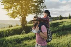 Son with father on mountain. Happy father and little son are walking in the mountains royalty free stock image