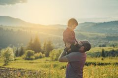 Son with father on mountain. Happy father and little son are walking in the mountains royalty free stock images
