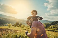 Son with father on mountain. Happy father and little son are walking in the mountains Royalty Free Stock Photography