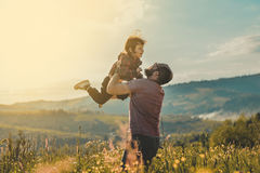 Son with father on mountain. Happy father and little son are walking in the mountains Stock Photo
