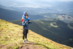 Son and father in mountains Royalty Free Stock Photo