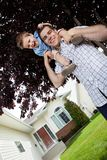 Son on Father's Shoulder. Son on his father's shoulders having fun Royalty Free Stock Image