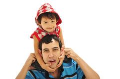 Son on Father's shoulders. Father and son playing together showing happiness Stock Image