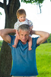 Son and father. Son sits on his father's shoulders royalty free stock photography