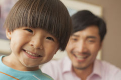 Son with father smiling, portrait royalty free stock photography