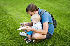 Son and father spend time together. Outdoors Royalty Free Stock Image